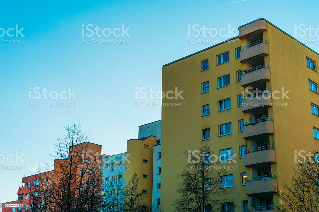 yellow and red plattenbau building with copy space stock photo