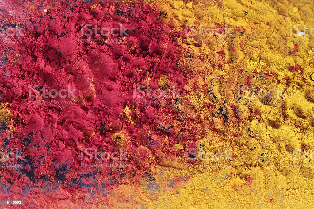 Yellow and red powder religious puja in a temple in India stock photo