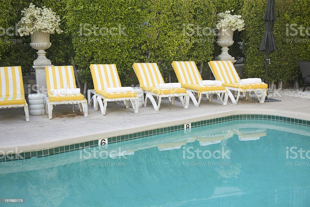 Yellow and White Striped Pool Furniture, Leisure, Summer, Relaxation stock photo