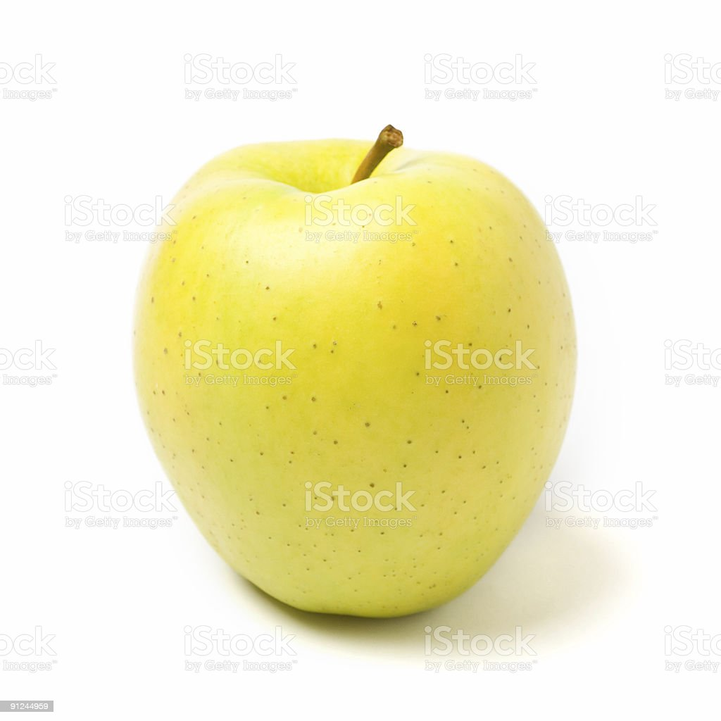 Yellow apple on white background with shadows stock photo