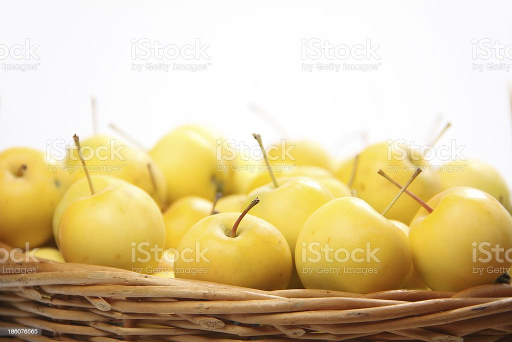 yellow apples in a wicker basket royalty-free stock photo