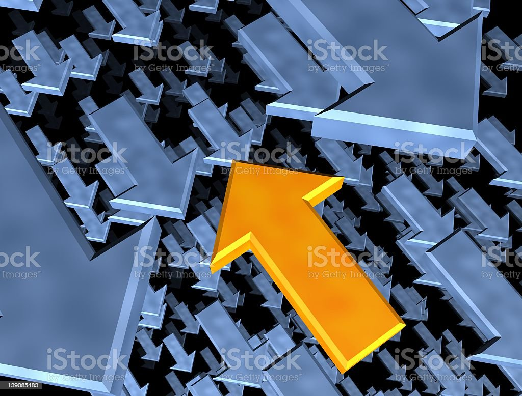 Yellow arrow in a field of opposing blue arrows stock photo