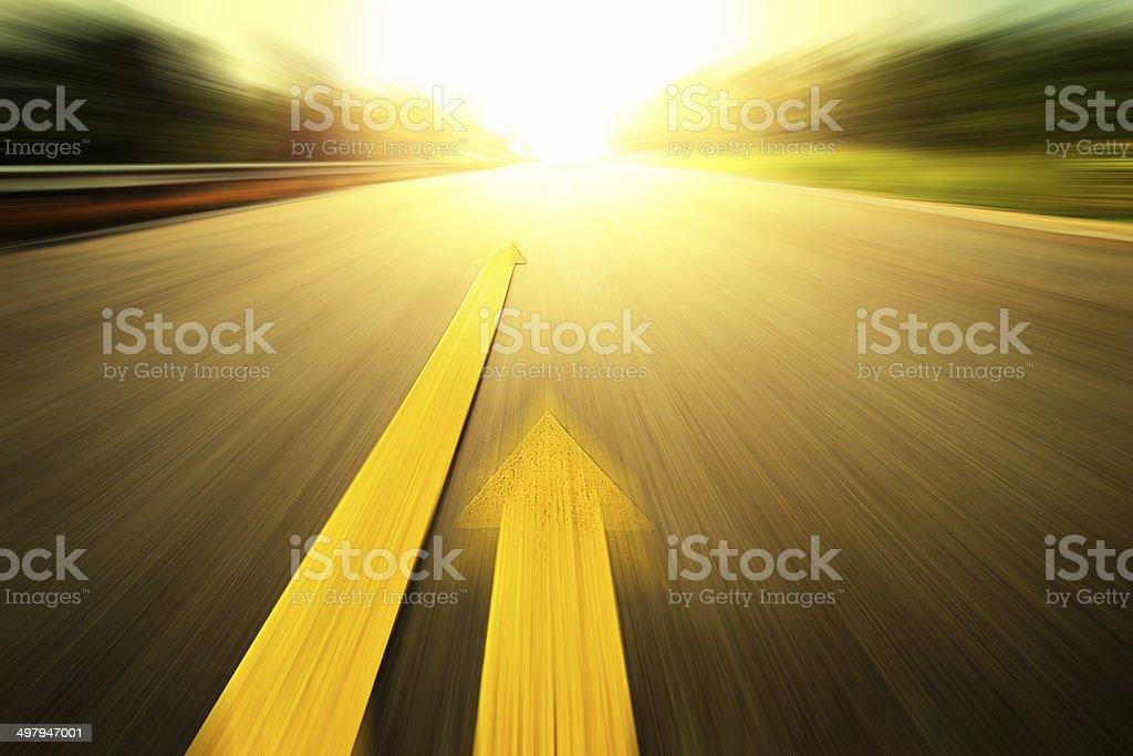 Yellow arrow Line exceeding on the road. stock photo