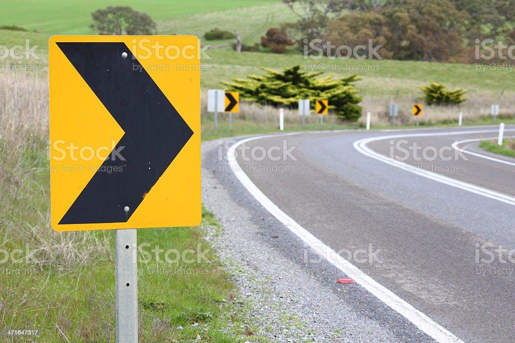 Yellow arrow road sign stock photo