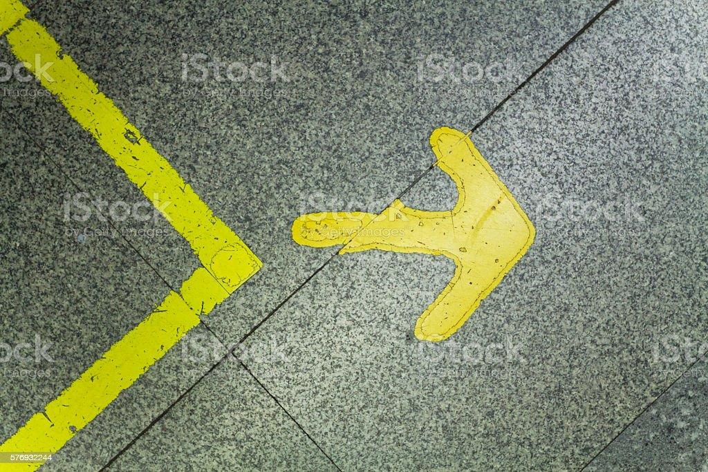 Yellow arrow sign stock photo