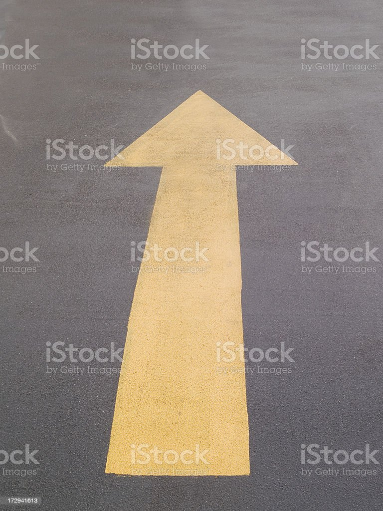Yellow arrow up and out stock photo