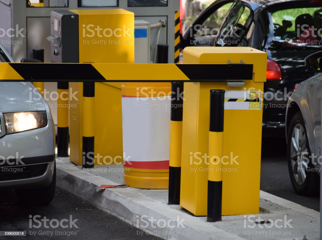 yellow Automatic parking barriers stock photo