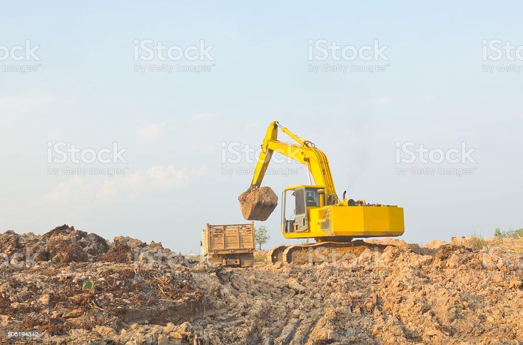 Yellow backhoe stock photo