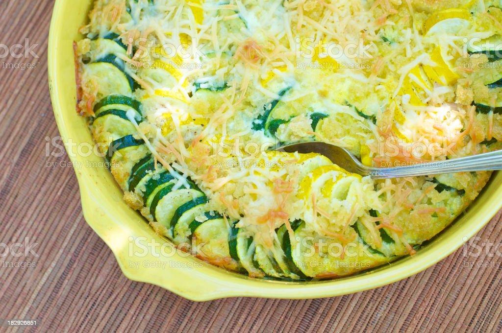 Yellow Baking Dish of Summer Squash Casserole stock photo