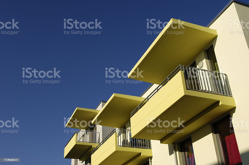 Yellow balconies and deep blue sky royalty-free stock photo
