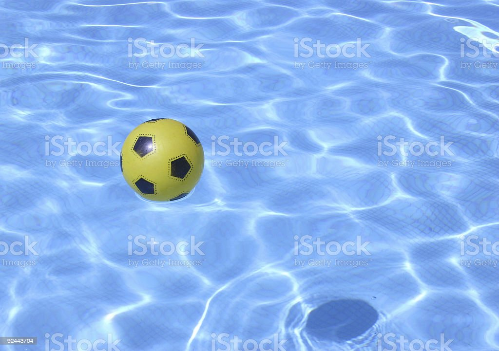 Yellow Ball in Pool royalty-free stock photo