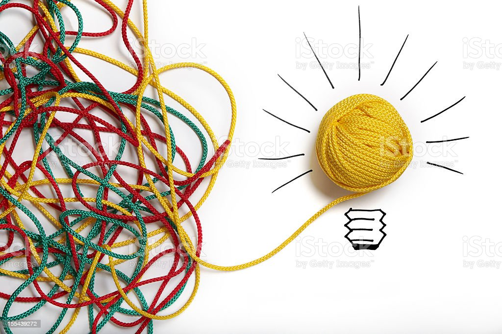 Yellow ball of wool with pen lines like lightbulb stock photo