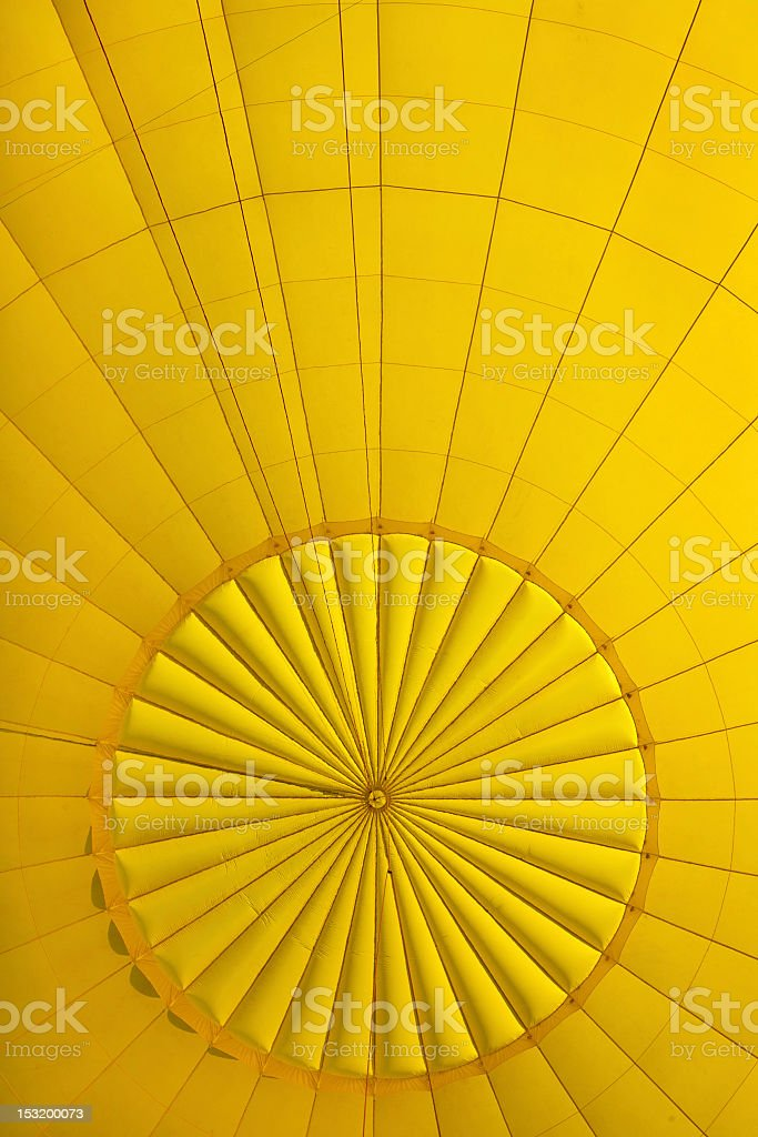 Yellow ballon inside air container stock photo