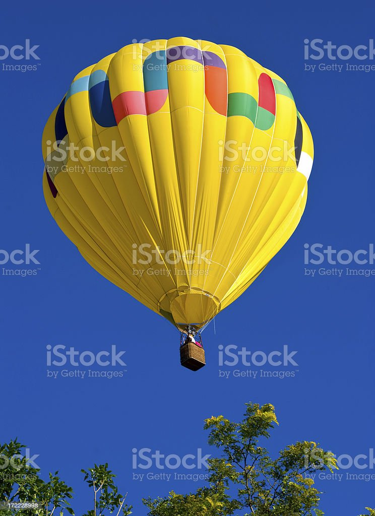 Yellow Balloon Isolated on a Deep Blue Sky 4 royalty-free stock photo