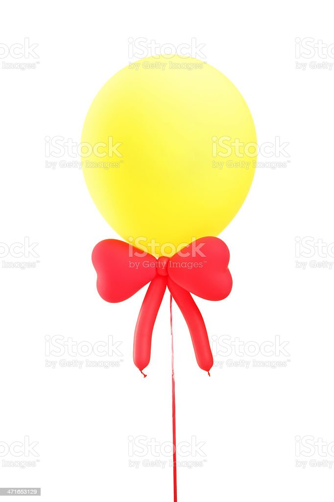 Yellow balloon with a red bow tie royalty-free stock photo