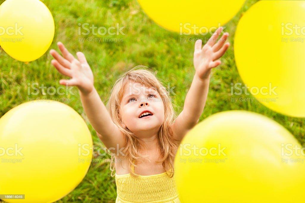 Yellow Balloons Around Little Girl royalty-free stock photo
