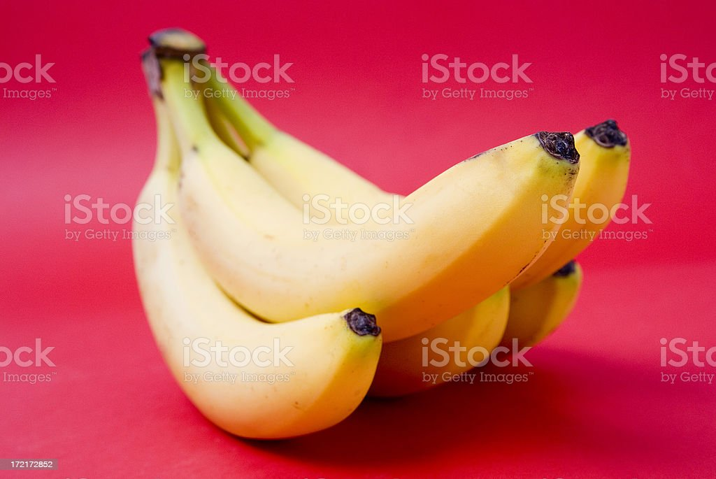 Yellow Bananas With A Red Background royalty-free stock photo
