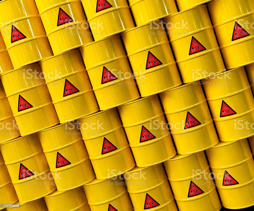 Yellow barrels of nuclear waste stacked diagonally royalty-free stock photo