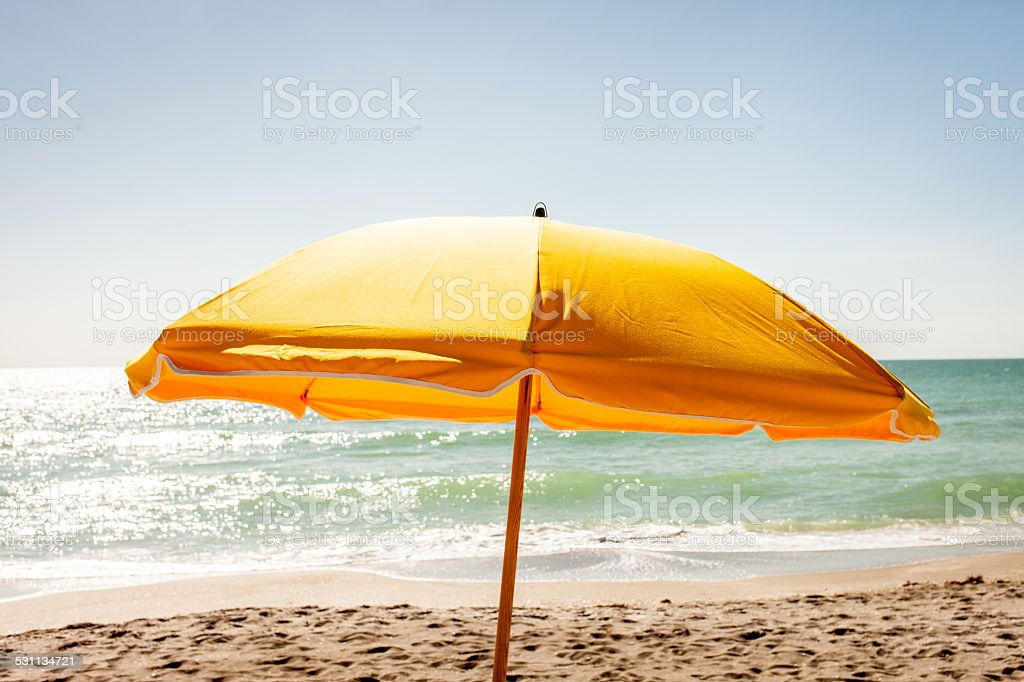 Yellow Beach Umbrella stock photo