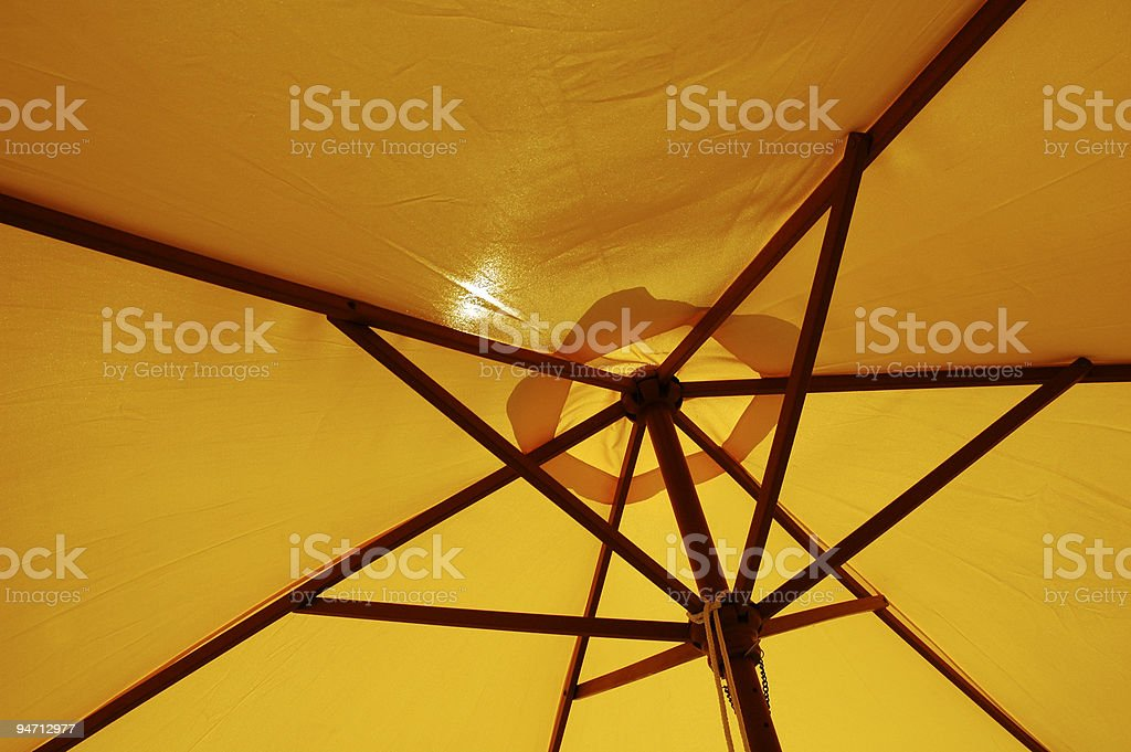 Yellow beach umbrella royalty-free stock photo