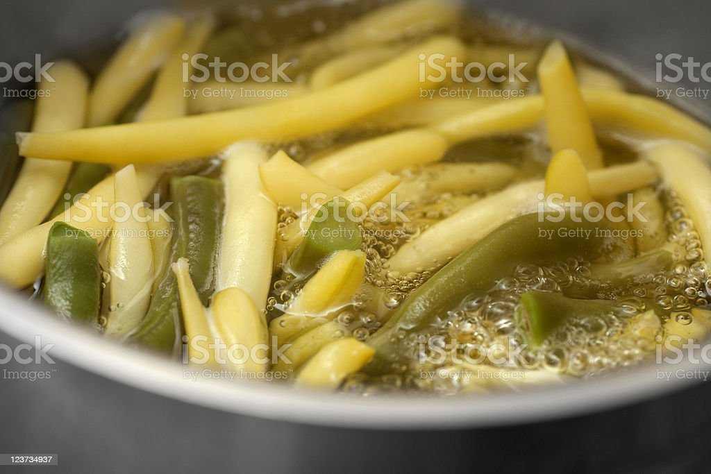 Yellow beans cooking in water stock photo