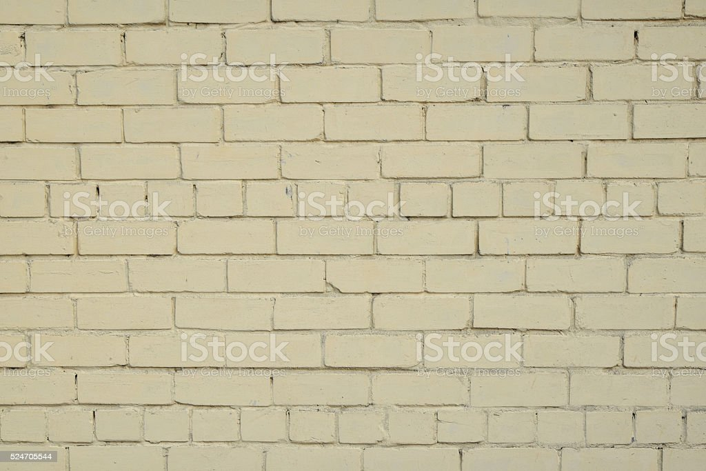 Yellow beige painted brick wall background royalty-free stock photo