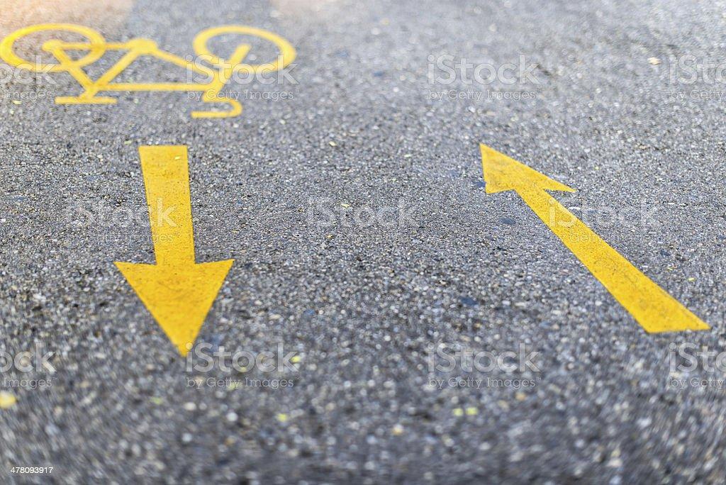 yellow bicycle lane road marking on asphalt royalty-free stock photo