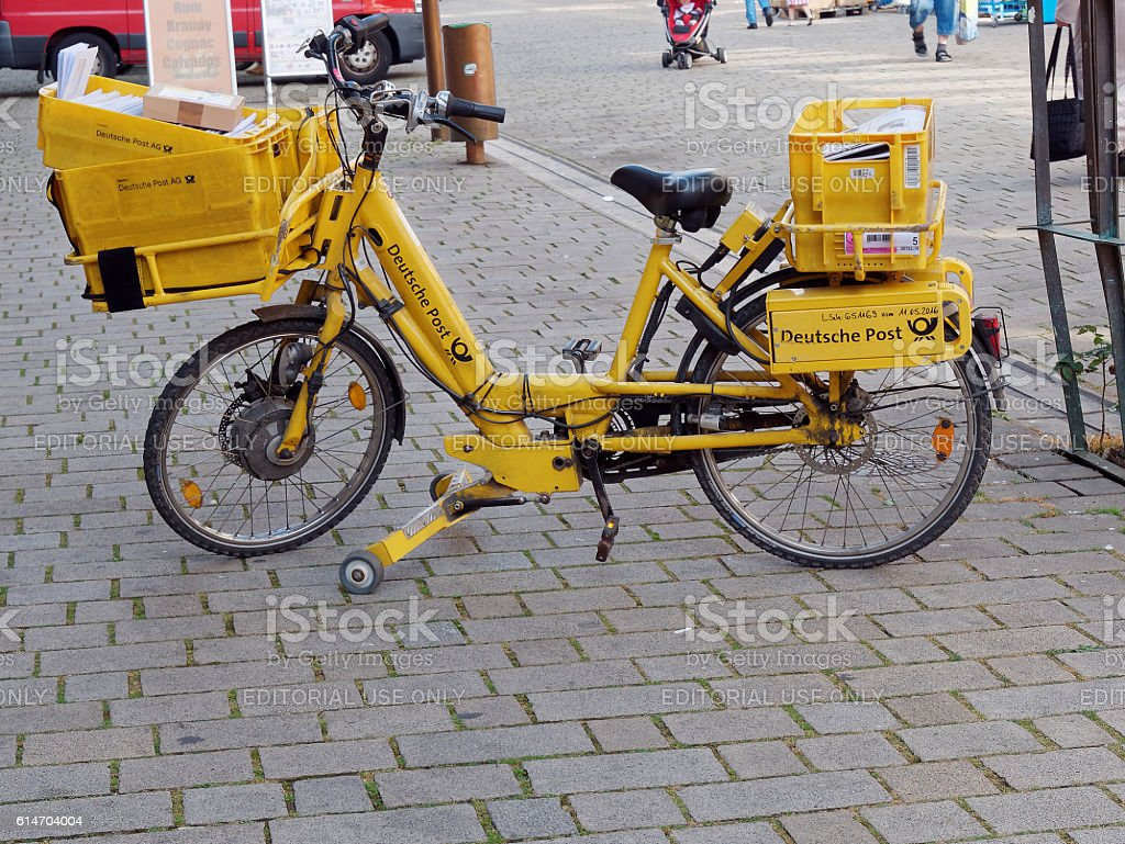 yellow bicycle of German Post stock photo