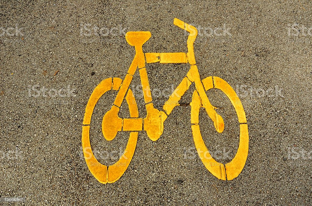 Yellow Bicycle Sign On Asphalt royalty-free stock photo