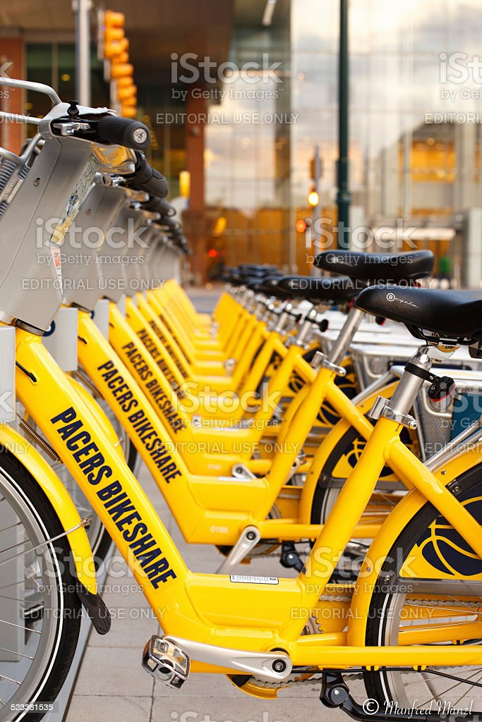 Yellow Bicycles in a row stock photo