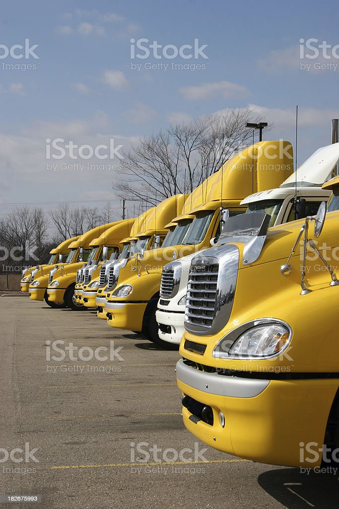 Yellow Big Rig LineUp Vertical stock photo