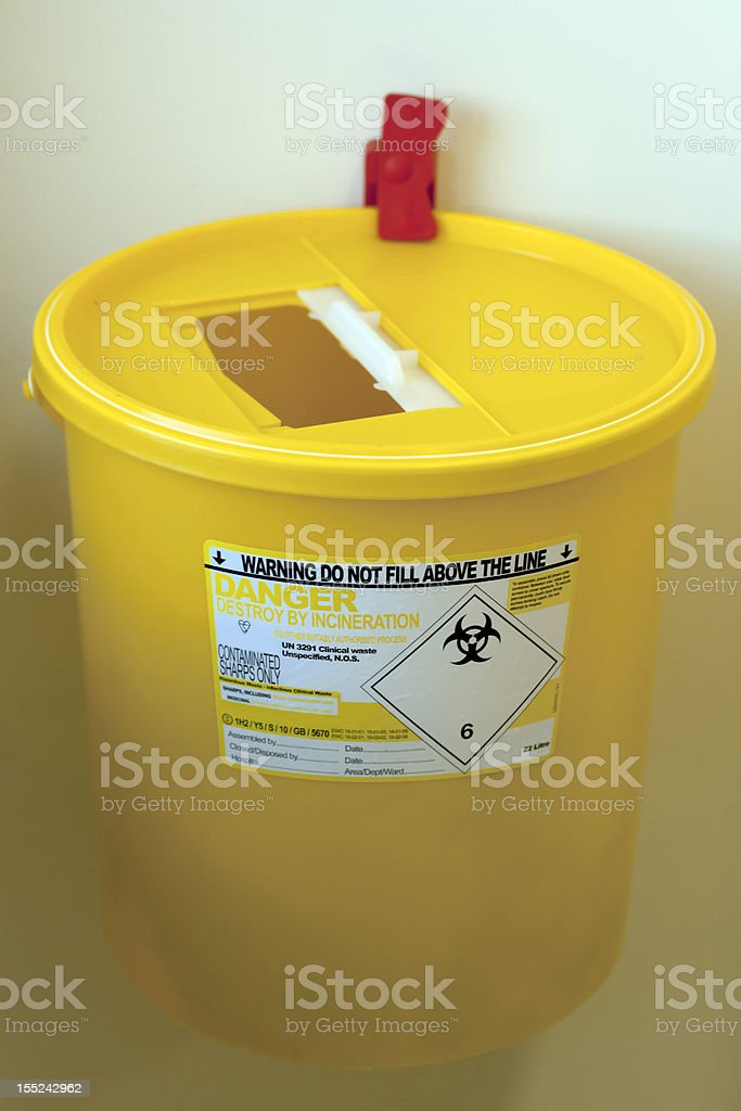 Yellow biohazard waste bin stock photo