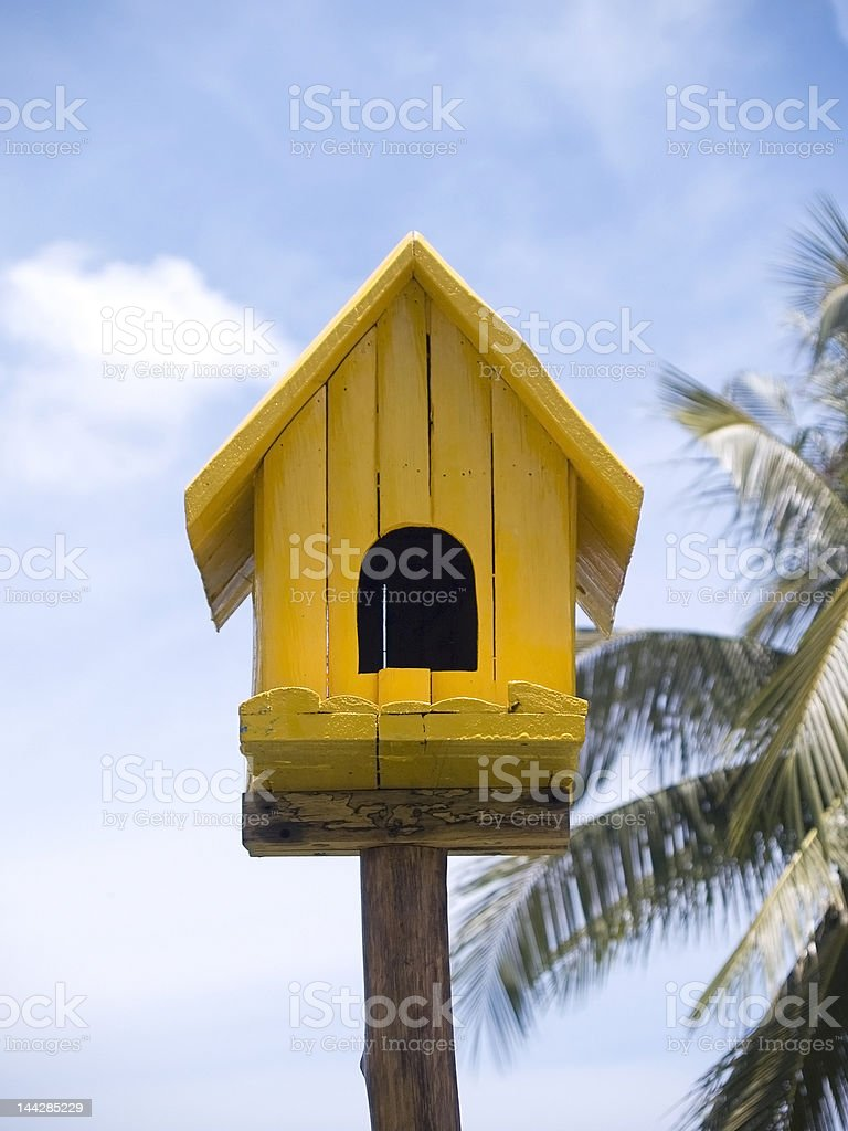 Yellow birdhouse royalty-free stock photo