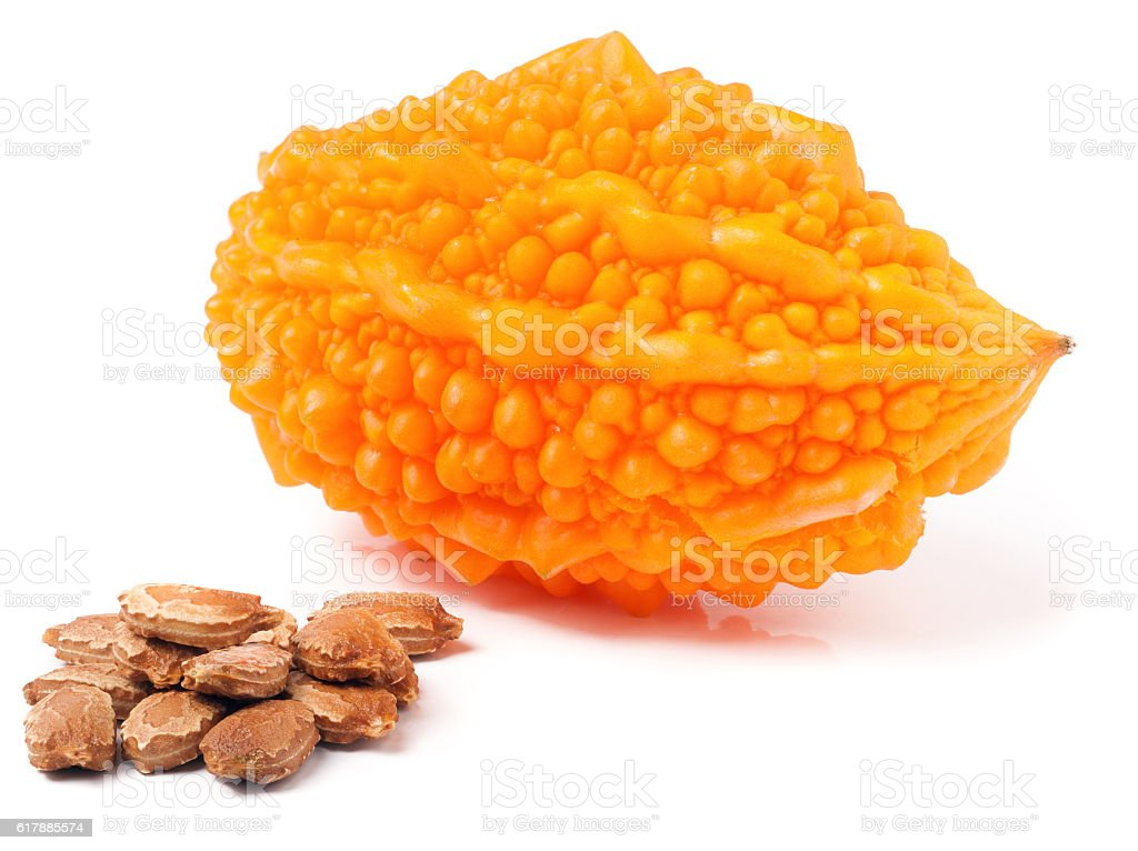 yellow bitter melon or momordica isolated on white background stock photo