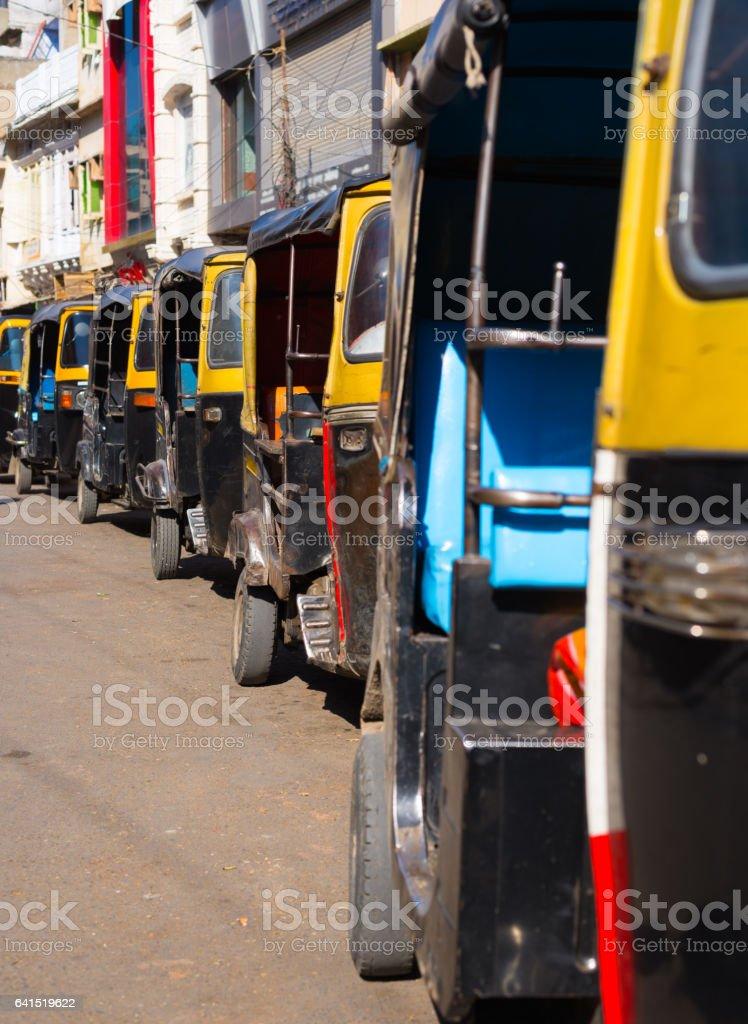 Yellow black rickshaws stock photo