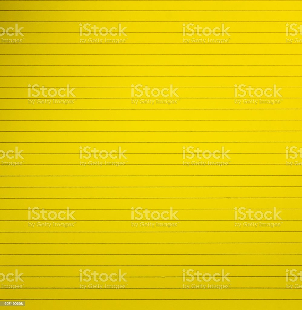 Yellow blank lined notebook paper page background stock photo