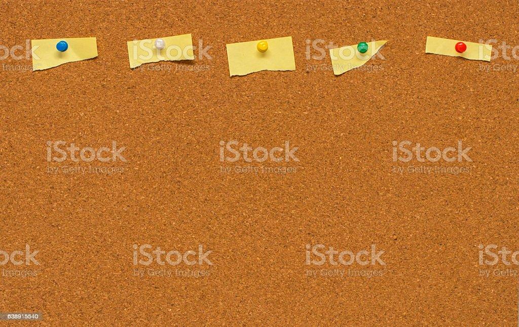 Yellow blank note on Cork board stock photo