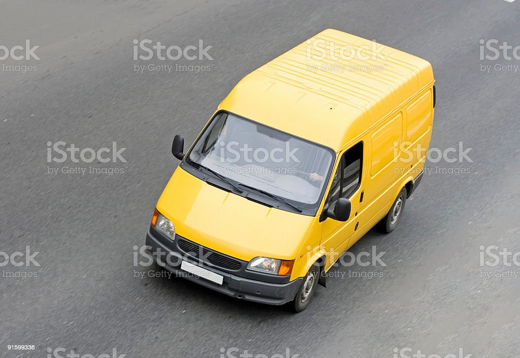 yellow blank pick-up van truck on road isolated royalty-free stock photo