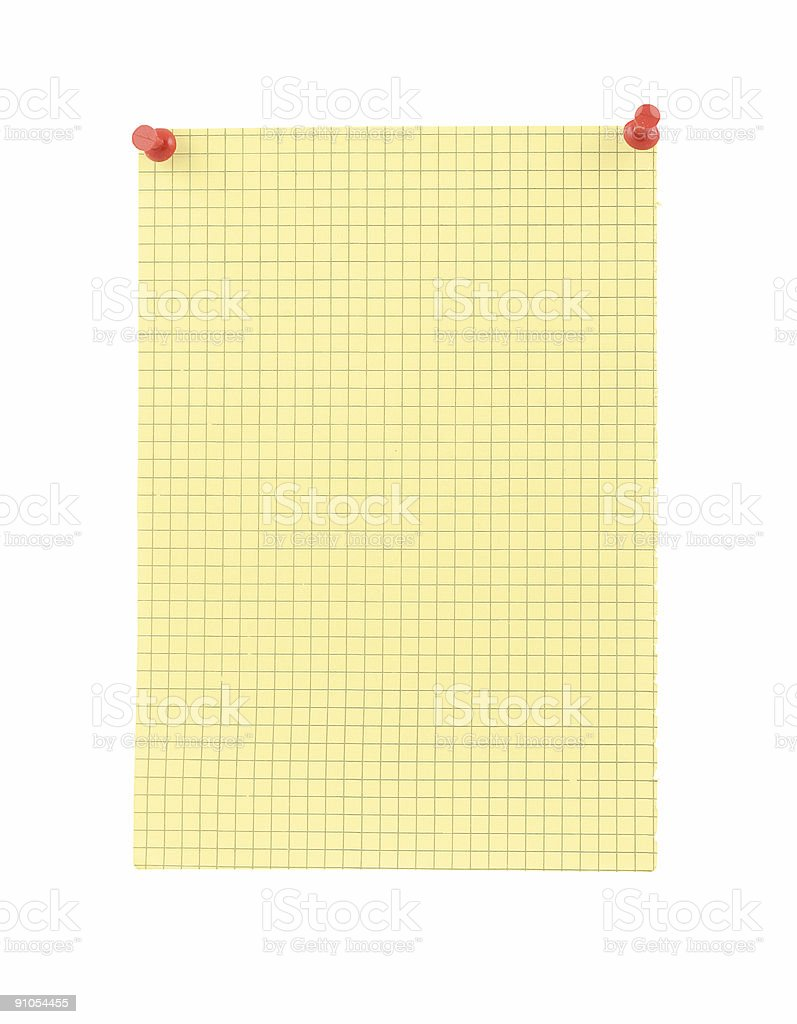 yellow blank thumbtacked squared paper page stock photo