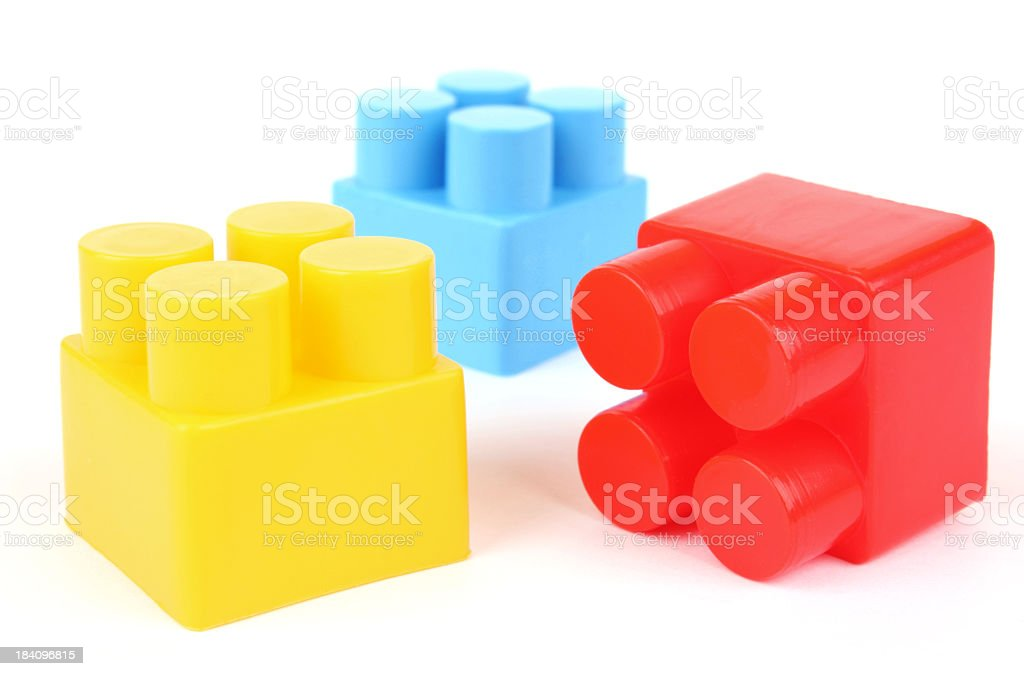 Yellow, blue, and red plastic building blocks stock photo