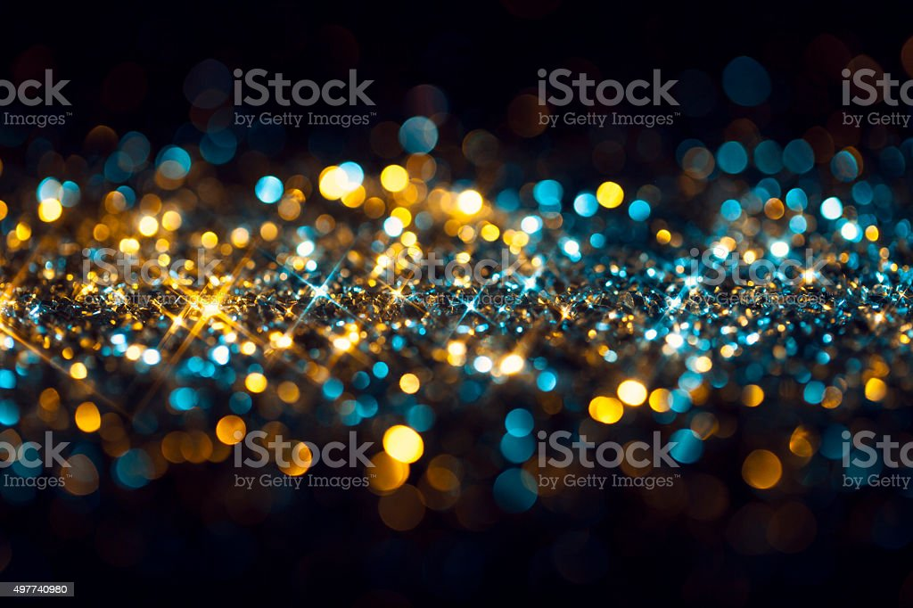 Yellow Blue Glitter on Black - Christmas Backgrounds Celebration stock photo