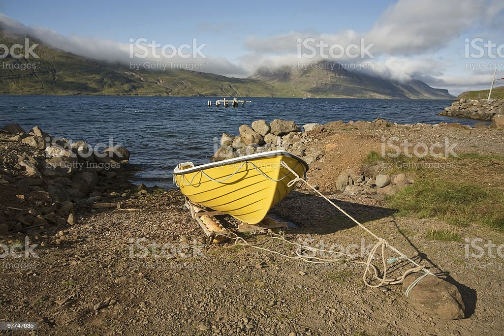 Yellow boat @ Blue bay in Iceland royalty-free stock photo
