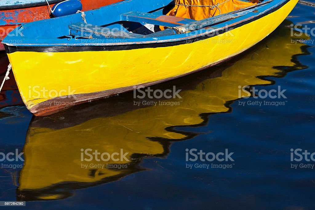 yellow boat with reflection stock photo