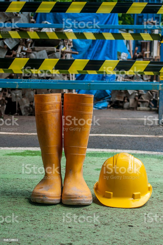 yellow boot and hard hat for safety construction stock photo