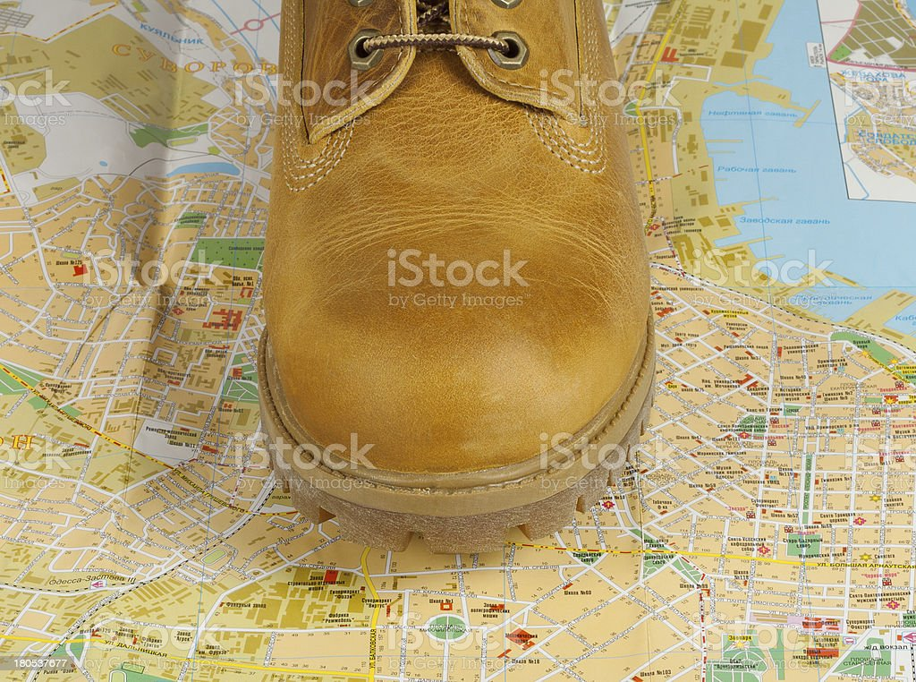 yellow boots standing on a map royalty-free stock photo