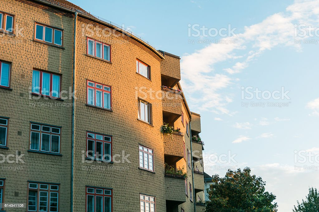 Yellow Brick Apartment Building in Warm Day Light stock photo