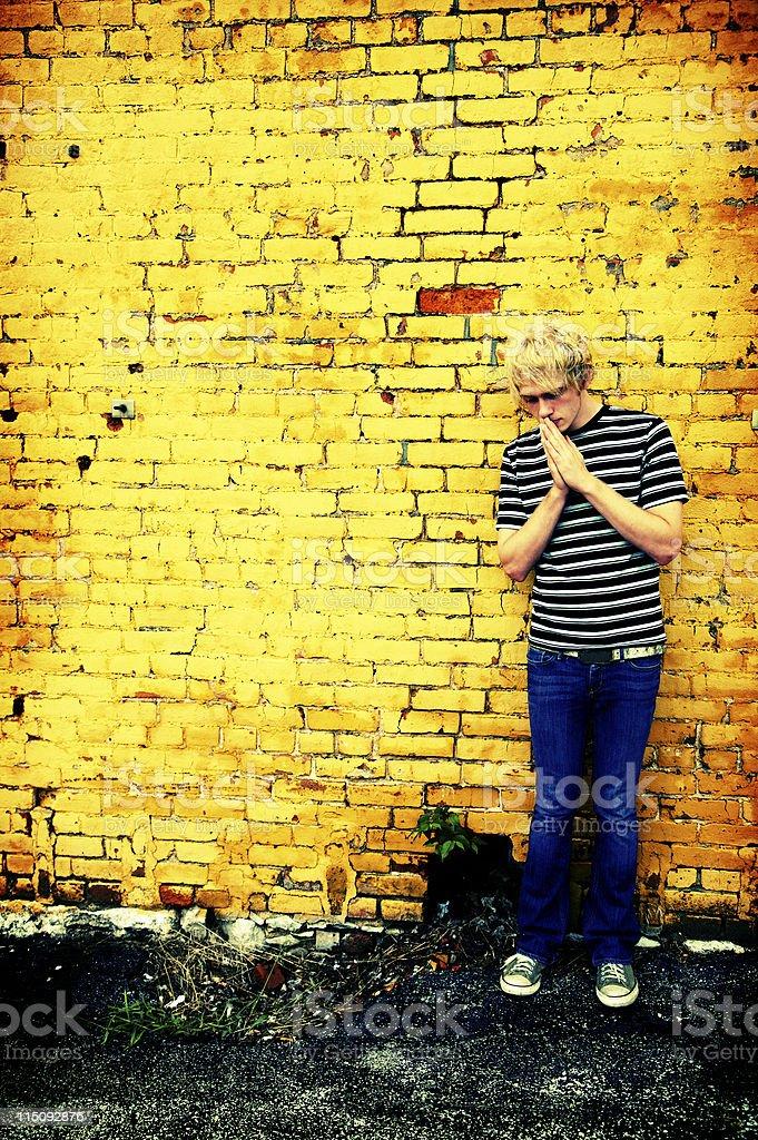 yellow brick wall prayer portraits royalty-free stock photo