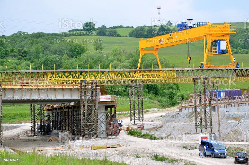 Yellow bridge crane on construction site of slovak D1 highway. stock photo