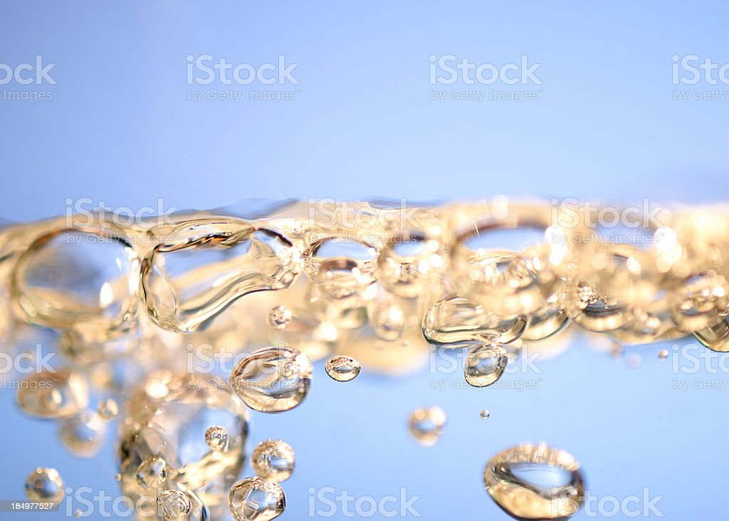 Yellow bubbles in blue water royalty-free stock photo