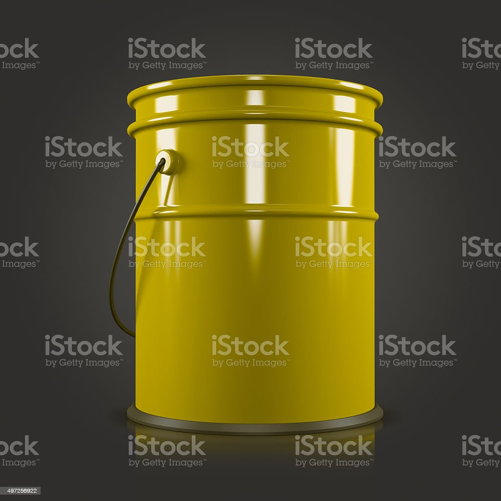 yellow bucket on a black background stock photo